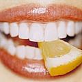 Slice Of Lemon Between Teeth by Cristina Pedrazzini