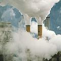 Smoking Chimneys Of A Paper Mill Polluting The Air by Kaj R. Svensson