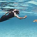 Snorkeler Photographing Green Turtle by Karen Doody