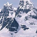 Snow-covered Mountains On Wienke by Gordon Wiltsie