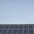 Solar Panels On A Roof by Bjorn Holland