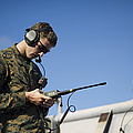 Soldier Conducts A Communications Check by Stocktrek Images