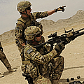 Soldier Directing A Fellow Soldier by Stocktrek Images