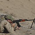 Soldier Fires A Russian Rpk Kalashnikov by Terry Moore