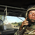Soldier Monitors The Progress Of A 67 by Stocktrek Images