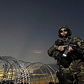 Soldier Patrols The Perimeter Of Camp by Stocktrek Images