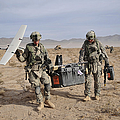 Soldiers Carry An Rq-11 Raven Unmanned by Stocktrek Images