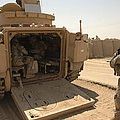 Soldiers Climb Into The Back Of A M2 by Stocktrek Images