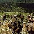Soldiers Descend The Side Of Hill 742 by Stocktrek Images