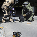 Soldiers Dressed In Bomb Suits Examine by Stocktrek Images