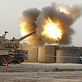 Soldiers Fire The Howitzers by Stocktrek Images