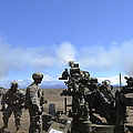 Soldiers Firing The M777 Howitzer by Stocktrek Images