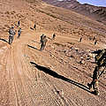 Soldiers Patrol To A Village by Stocktrek Images