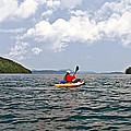 Solitary Man In Kayak by Susan Leggett