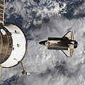 Space Shuttle Atlantis And The Docked by Stocktrek Images
