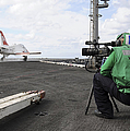 Specialist Records Video Of Flight Deck by Stocktrek Images