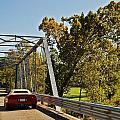Sports Car On A Bridge by Susan Leggett