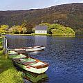 St. Finbarres Oratory And Rowing Boats by Ken Welsh
