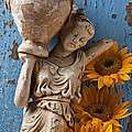Statue Of Woman With Sunflowers by Garry Gay