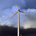 Storm Clouds And Wind Turbine by Alan Hutchins