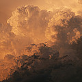 Storm Clouds Gather Over The Badlands by Annie Griffiths