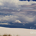 Storm's Contrast With White Sand by Roena King