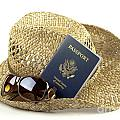 Straw Hat With Glasses And Passport by Blink Images