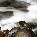 Stream Flowing Over Rocks by Les Cunliffe