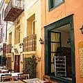Street Cafe Greek Restaurant In Nafplion Greece by John Shiron