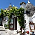 Street Scene In Alberobello by Carla Parris