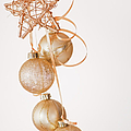 Studio Shot Of Gold Christmas Ornaments by Daniel Grill