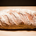 Studio Shot Of Loaf Of Bread by Kristin Lee