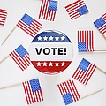Studio Shot Of Vote Pin And Small American Flags by Winslow Productions