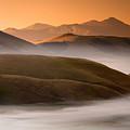 Sunrise Castelluccio Di Norcia In Morning Fog by Michele Berti