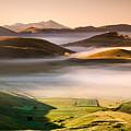 Sunrise In Castelluccio Di Norcia In Morning Fog by Michele Berti