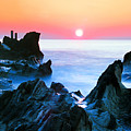 Sunset At Sea With Rocks In Foreground by Midori Chan-lilliphoto