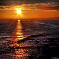 Sunset On The Beach by Phil Huettner