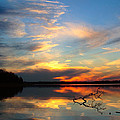 Sunset Over Calm Lake by Daniel Reed