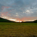 Sunset Over Field by Azthet Photography