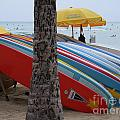 Surfboards On Waikiki Beach by Mary Deal