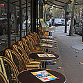 Tables Outside A Paris Bistro On An Autumn Day by Louise Heusinkveld