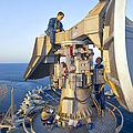Technicians Perform Maintenance by Stocktrek Images