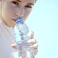 Teenage Girl Drinking Water by Cristina Pedrazzini