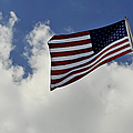 The American Flag Blowing In The Breeze by Stocktrek Images