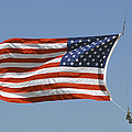 The American Flag Waves At Half-mast by Stocktrek Images