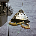 The Apollo 9 Command Module Is Hoisted by Stocktrek Images