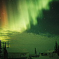 The Aurora Borealis Shimmers by Norbert Rosing