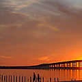 The Biloxi Bay Bridge At Sunset by David R Frazier and Photo Researchers