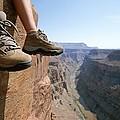 The Boot-shod Feet Of A Hiker Dangle by John Burcham