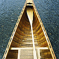 The Bow And Oar Of A Handmade Wooden by Bill Curtsinger